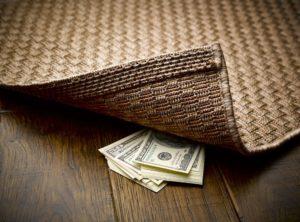money under the rug