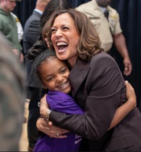 Kamala Harris hugging young girl